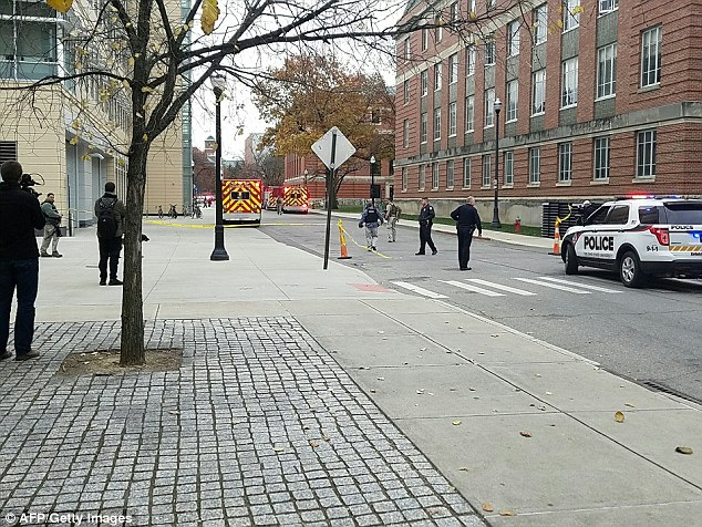 A photo taken by Ohio State University's student newspaper shows a team of police securing an area of the campus after the situation on Monday