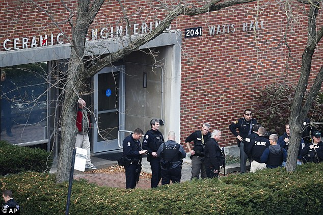 Police gather outside of Watts Hall on Monday, after the assailant was killed