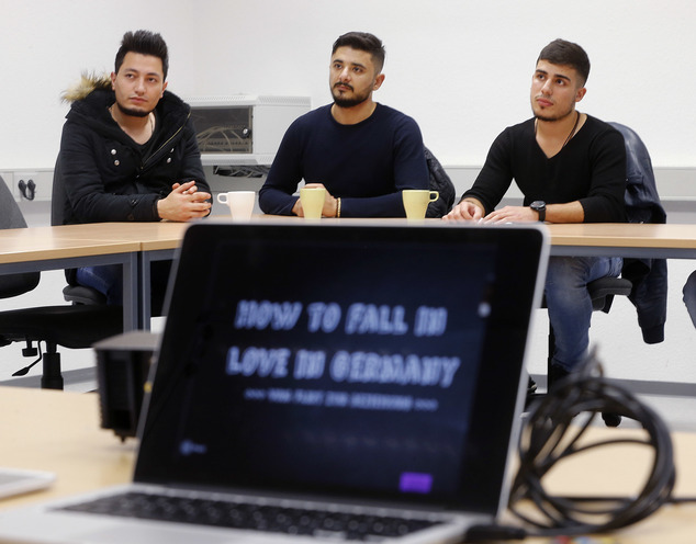 Refugees take part in a flirt workshop called 'how to fall in love in Germany' in Dortmund, Germany