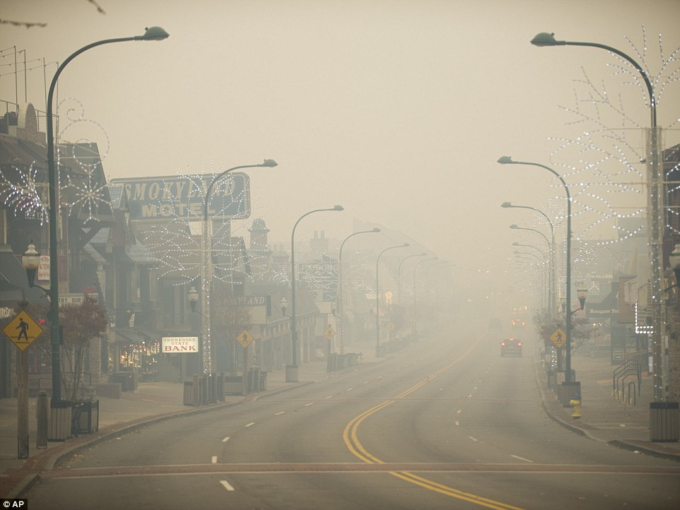 Thick smoke obscured the roads in Gatlinburg on Monday afternoon as the wildfires grew closer