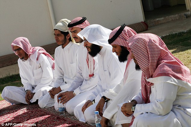 The facilities are meant to help former jihadists integrate into society, with psychologists and religious officials on hand (pictured released Gitmo detainees listening to a Muslim cleric)