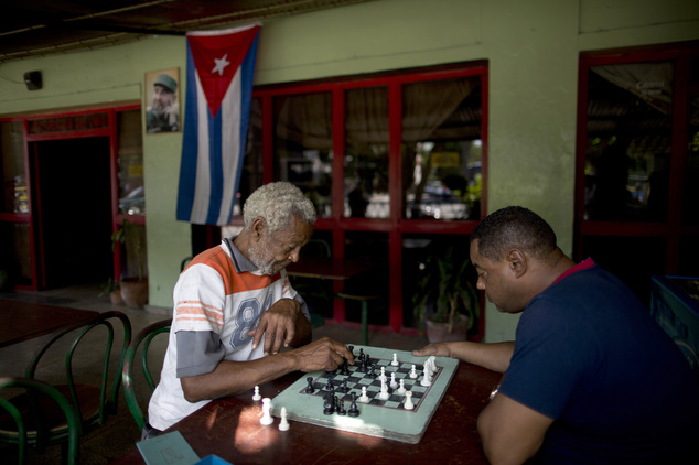 Men play chess at a bar near Revolution Plaza, the site of two days of tributes to the late Fidel Castro, in Havana, Cuba, Monday, Nov. 28, 2016. Thousands o...