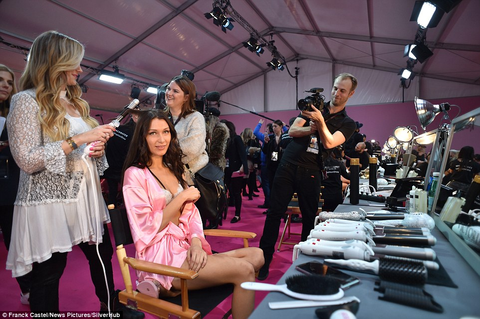 Snap snapping away! Bella glowed in her pink ensemble among the cast and crew in their muted colours