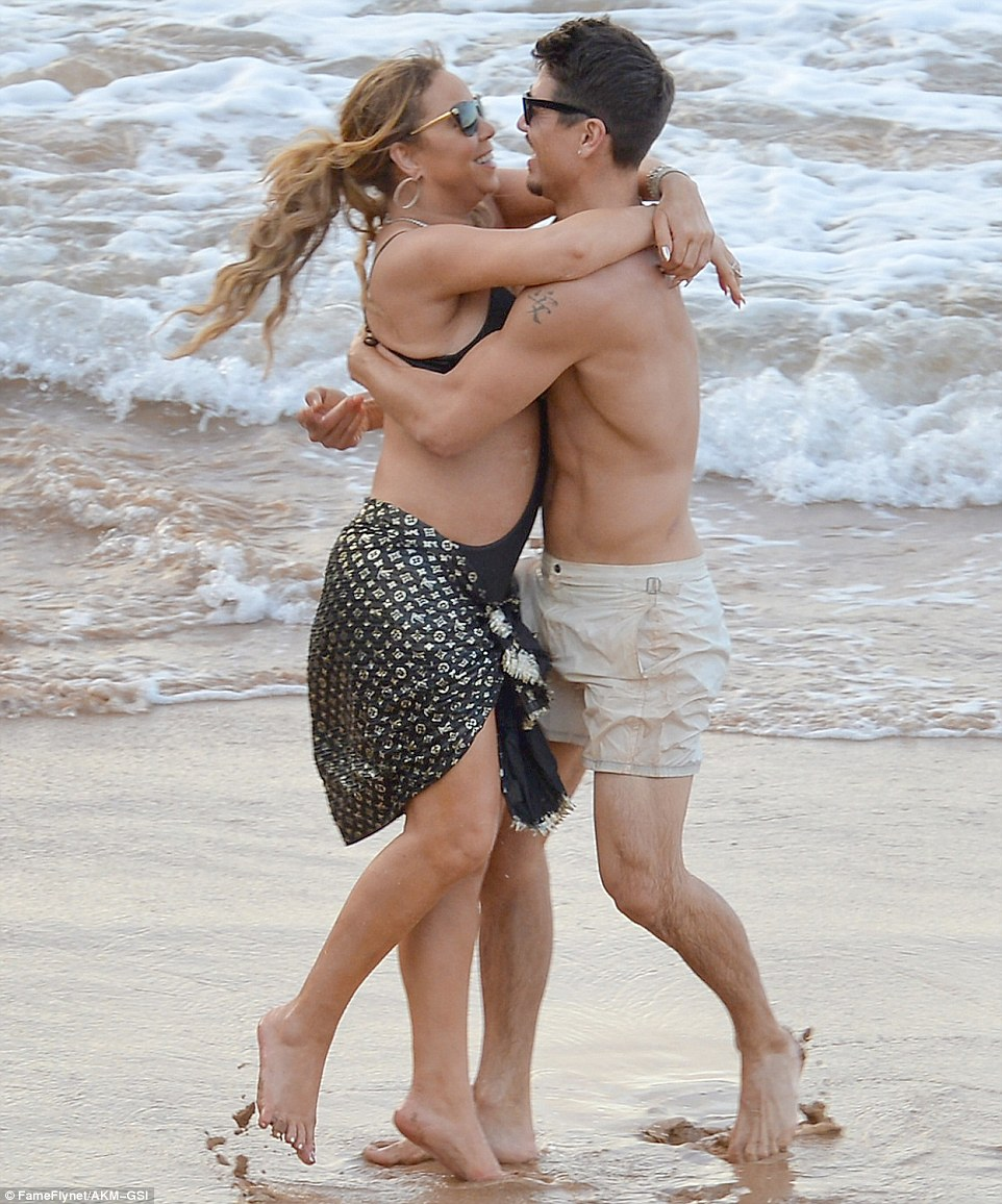 PDA alert: Mariah couldn't keep her hands - or lips - off the 33-year-old back-up dancer