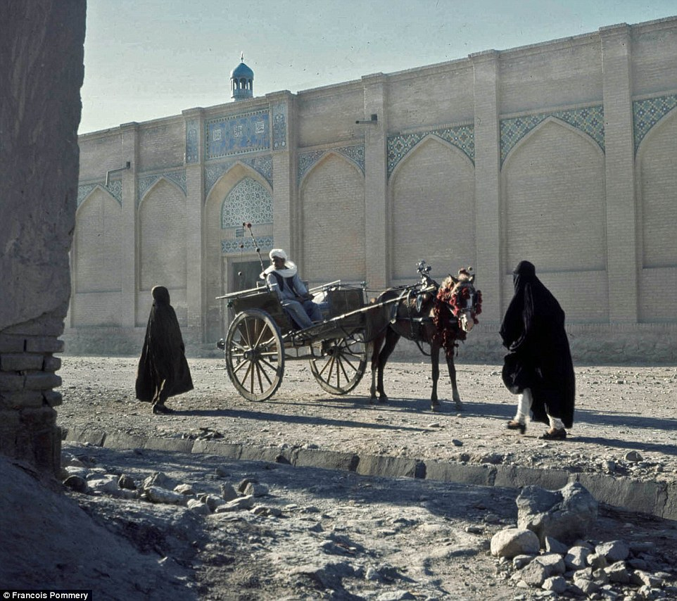 Two women in veils approach a horse and cart in Hérat - Afghanistan's third-largest city