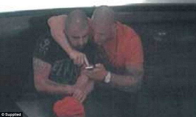 Quami is pictured sitting with slain underworld hitman Pasquale Barbaro