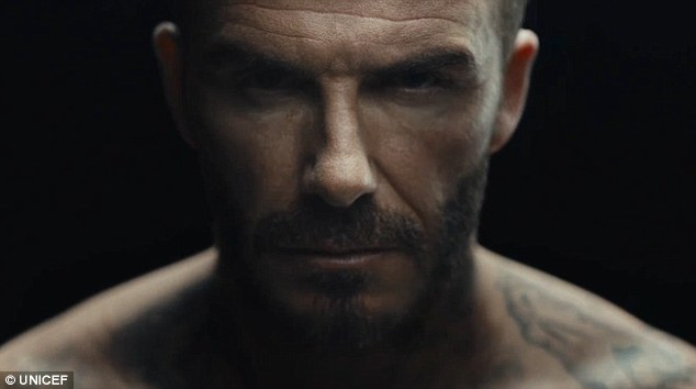 Moving: In a campaign video for UNICEF, David Beckham gets some new ink as animated drawings depicting  violent acts against children come to life on his skin