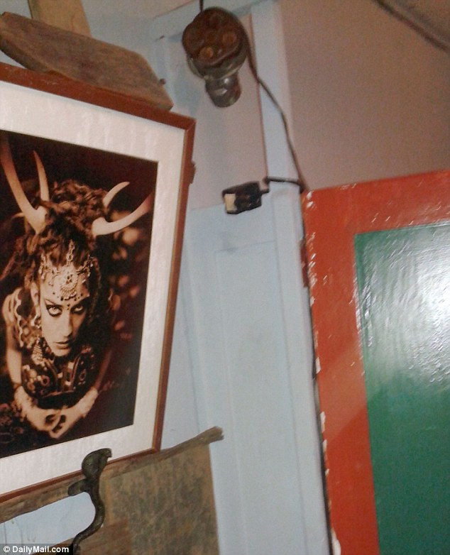Weird: The art in the warehouse was apparently inspired by Almena's interest in mysticism even if some of it had unclear references such as the picture on a wall seen above