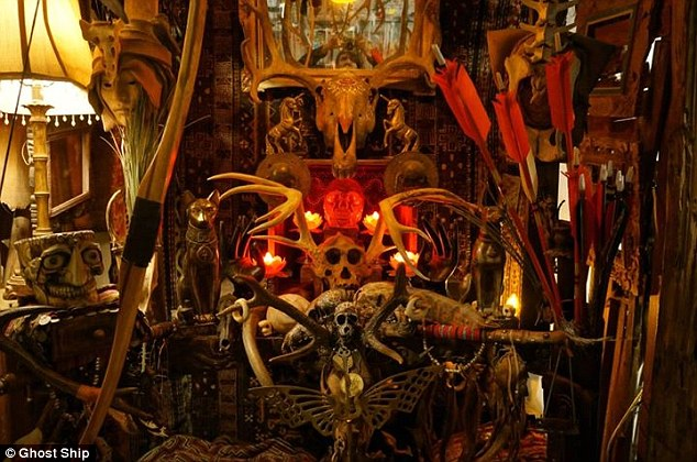 Sinister: Skulls and skull figurines, a bow with arrows, unicorn statues and candles filled a crowded space in one room.