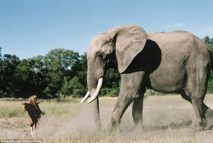 While most children would be intimidated at the sight of 34-year-old elephant Abu, she appeared totally at ease in Botswana