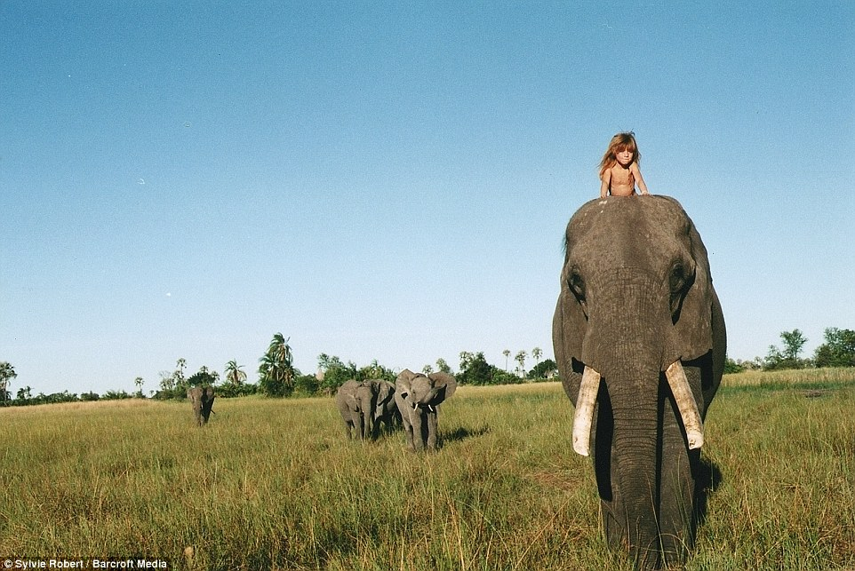 Incredible: Her mother snapped this image of Tippi riding on the top of elephant Abu's head in Botswana when she was six