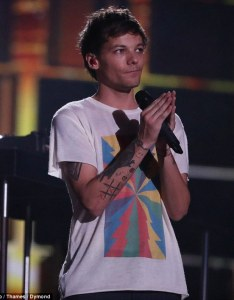 Chart topper louis tomlinson   debut single has topped the itunes charts following his emotional performance also tops after  factor rh dailymail
