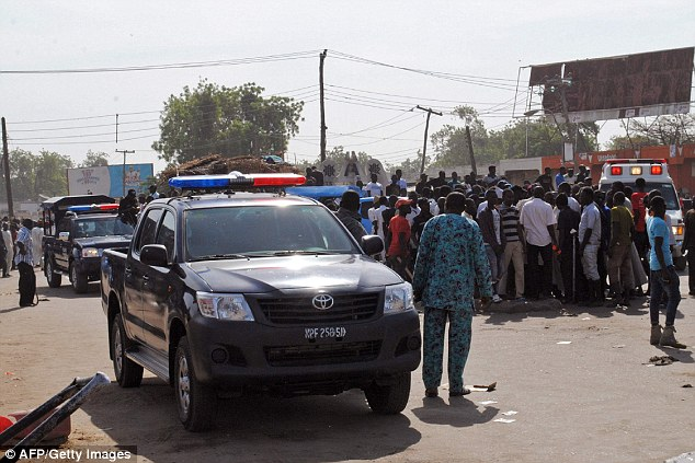 Pictured: Security services arrive at the market in the town ofMaiduguri, which lies in the Boko Haram stronghold of Borno state,
