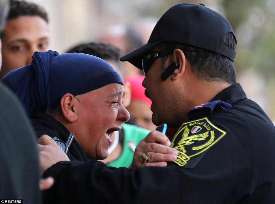 Relatives of the victims were held back from the scene by police officers following the blast