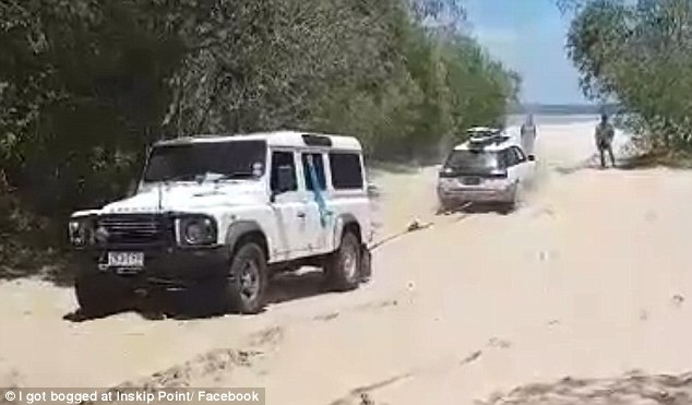 A group of backpackers who got their car stuck on a beach thought they were in luck when a 4x4 owner offered to tow them out of the sand