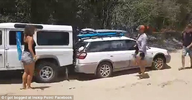 As the Land Rover comes to a gentle stop after pulling the Subaru for a few metres, the car driver fails to notice and continues to reverse into it