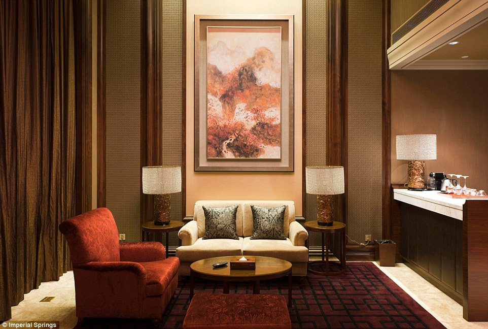 Each suite has its own spacious lounge area (above), where guests can enjoy complimentary coffees and teas