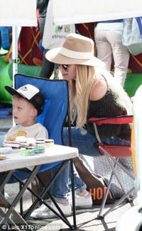 Hilary Duff enjoys festive funday with son Luca at Farmers ...