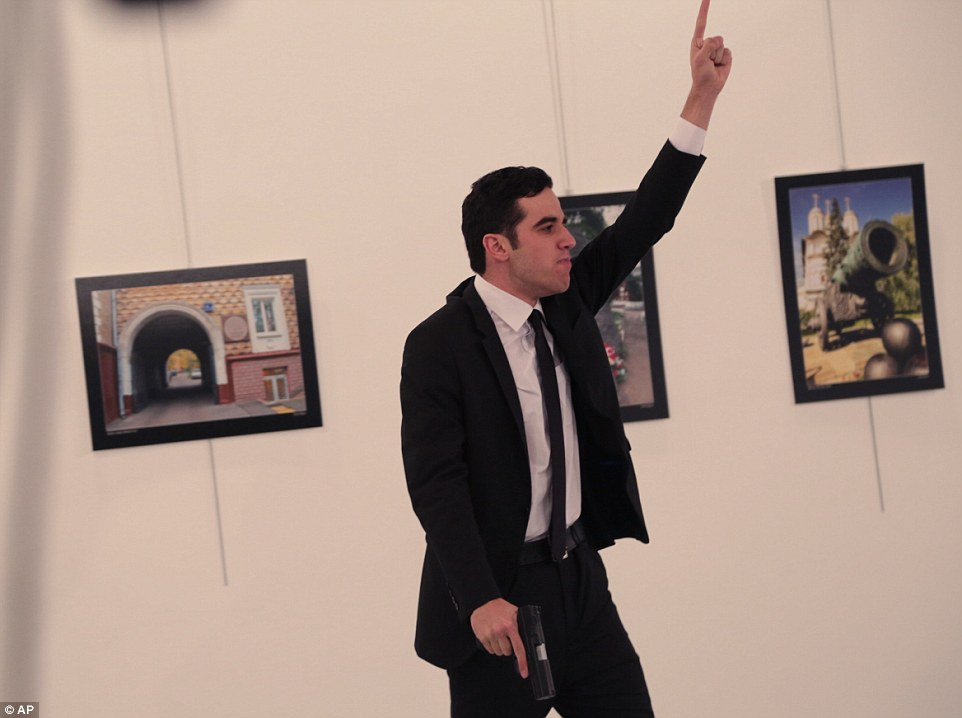 Altintas waved his arms in the air as he shouted at the terrified visitors inside the gallery