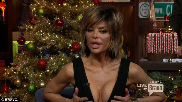 Lisa Rinna strips down to her black bra and undies for