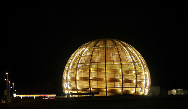 The globe of the European Organization for Nuclear Research, CERN, is illuminated outside Geneva, Switzerland