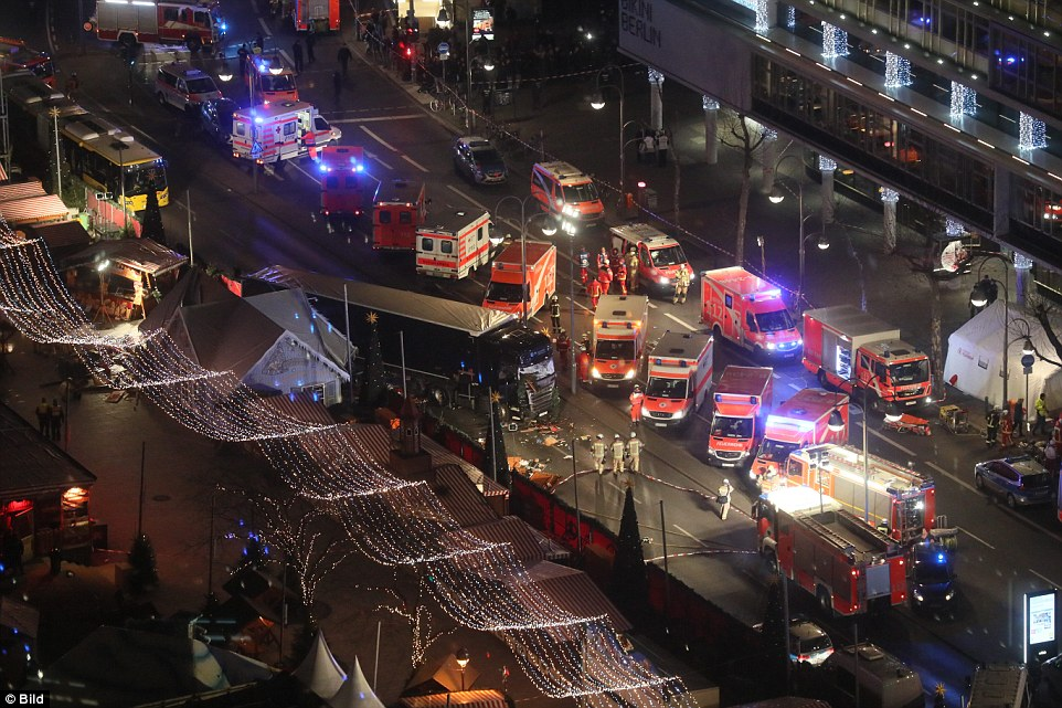 Police said on Twitter that they had taken one suspect into custody and another passenger from the truck had died as it crashed into people gathered around wooden huts at the foot of the Kaiser Wilhelm memorial church