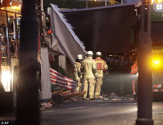 Police say the 32 ton truck smashed the wooden stalls of the market to matchwood and pulverised the humans caught in it path next to the Kaiser Wilhelm Memorial Church - a ruin of World War Two that stands as a monument against war