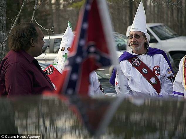 Davis with a Klan member. He said that most racists he knows voted for Donald Trump in the November presidential election