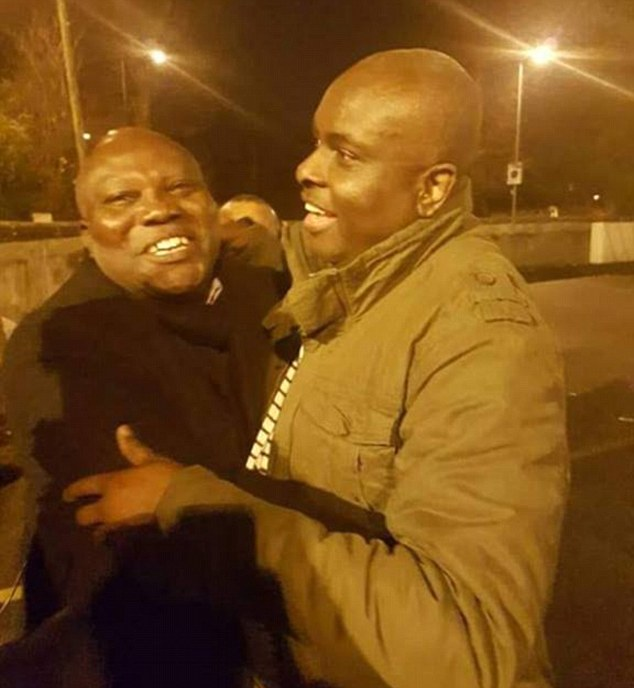 Crook: Corrupt James Ibori (right) is met by a friend after his release