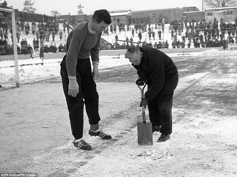Watford's Tom Palmer (r), was one of the few groundsmen in the country able to get his ground fit for play on this weekend