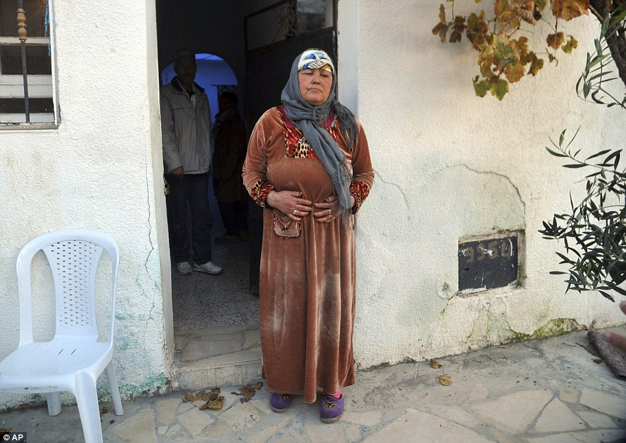 Nour El Houda Hassani, the mother of Anis Amri, reacts after the death of her son in Oueslatia, central Tunisia