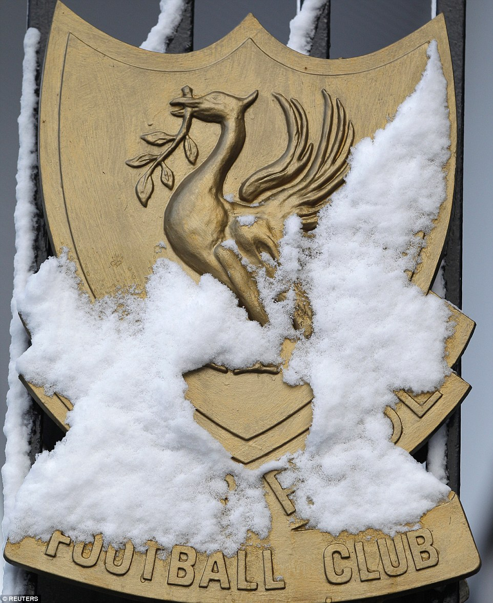 Snow covers the famous club crest outside Liverpool's Anfield stadium one week before Christmas Day in 2010
