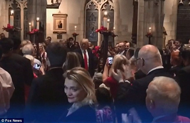 Some members of the congregation stood up and clapped when the Trumps arrived before they sat in one a pew among the other churchgoers