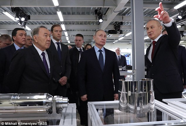 The 64 year old Kremlin president (centre) visited the Biocad plant in St Petersburg with ailing Kazakhstan leader Nursultan Nazarbayev (left, front), 76, who has failed so far to nominate his heir in his energy-rich central Asian state despite his advanced years
