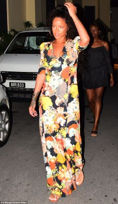 A night out: Rihanna dazzled in a cleavage-baring floral maxi dress when she headed out to dinner on Tuesday night in Barbados