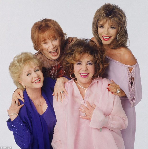 Despite the remarkable betrayal by her friend, Reynolds forgave Taylor (above together with Shirley MacLaine and Joan Collins in 2001