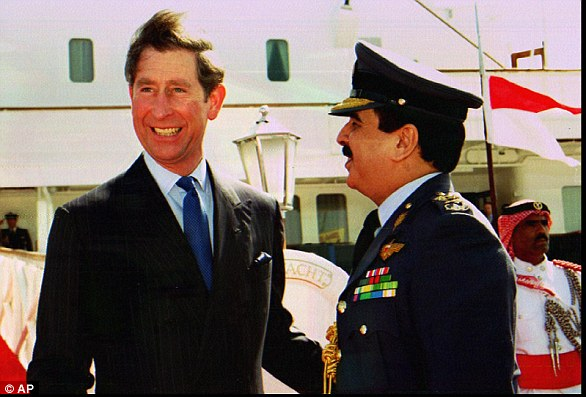 Britain's Prince Charles, left, is greeted by Crown Prince Sheik Hamad bin Isa Al Khalifa of Bahrain as he lands at Manama in 1997