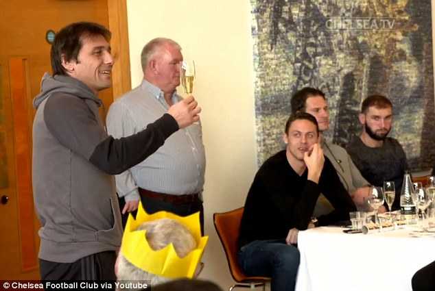 Chelsea boss Antonio Conte raises a glass of champagne to his table-topping Chelsea squad