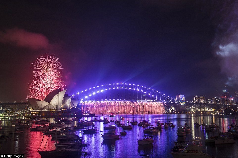 Fireworks explode over the Sydney Harbour Bridge and the Sydney Opera House during the 9pm show on New Year's Eve