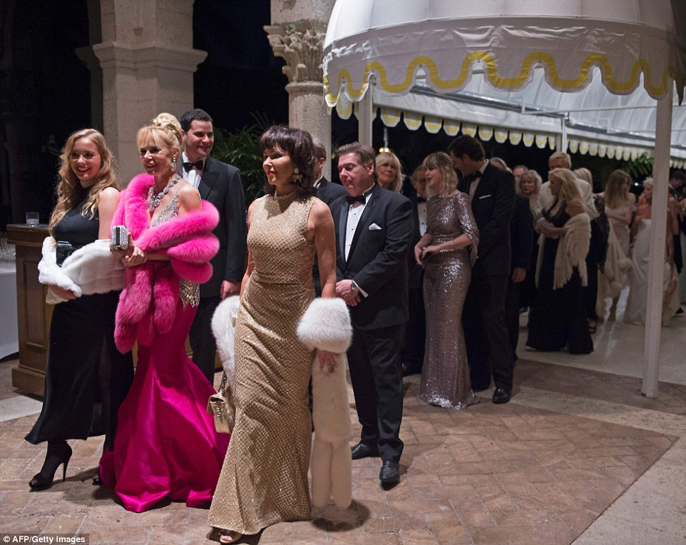 Party goers line up to enter US President-elect Donald Trump's New Year's Eve at the Mar-a-Lago in Palm Beach on Saturday night