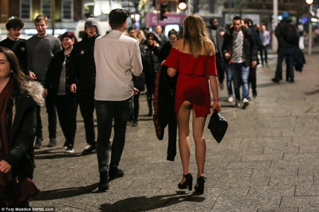 A girl in a red dress in Nottingham reveals more than she intended during the raucous celebrations across the country