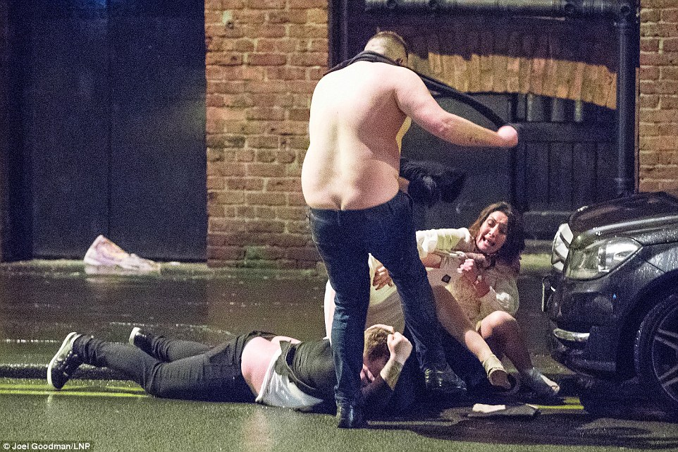 Celebrations turned ugly in Manchester as a flabby shirtless man kicks out at another man lying on the ground