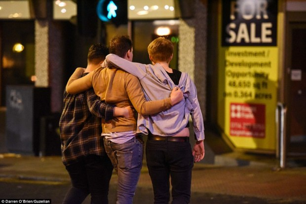 A reveller in Sheffield is helped home by two friends after enjoying one drink too many during last year's celebrations