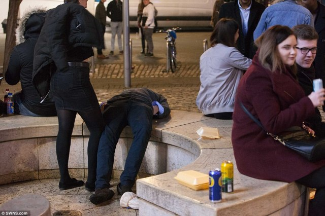 A party-goer in Bristol takes an early nap after a heavy night celebrating the beginning of 2017 in the city