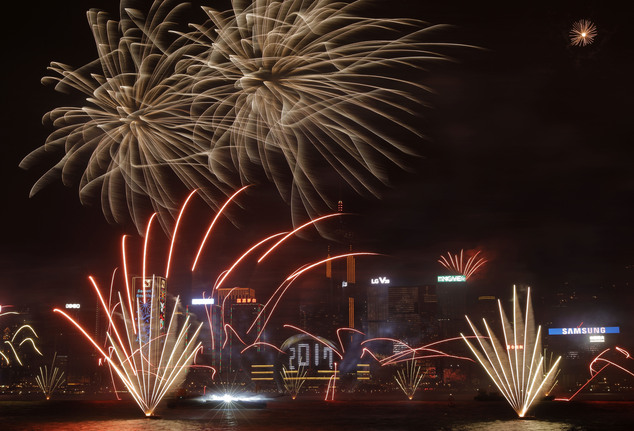 Fireworks explode over Victoria Harbour to celebrate the New Year's Eve in Hong Kong, early Sunday, Jan. 1, 2017. (AP Photo/Vincent Yu)