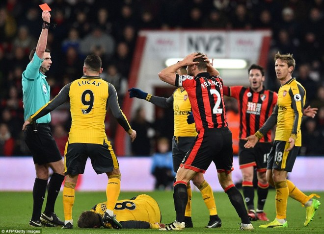 Referee Michael Oliver pictured showing a red card to Bournemouth's Simon Francis in the 82nd minute