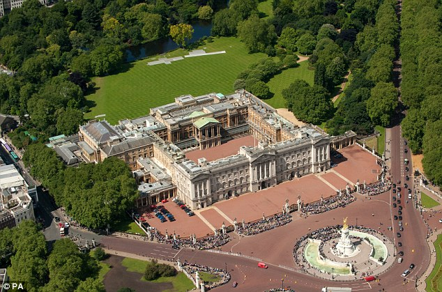 High alert: The guard is said to have shouted into the darkness when he spotted a figure walking around Buckingham Palace at 3am, believing it might be an intruder