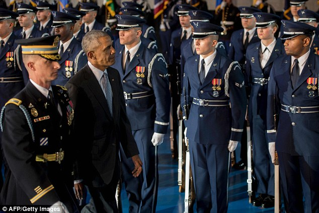 US President Barack Obama inspects US troops during an Armed Forces Full Honor Farewell Review at Joint Base Myer-Henderson in Arlington, Virginia
