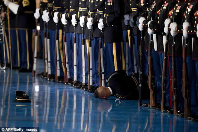 A member of the U.S. Army Honor Guard dramatically passed out and fell to the floor in front of Barack Obama during the president's farewell speech to the armed services on Wednesday