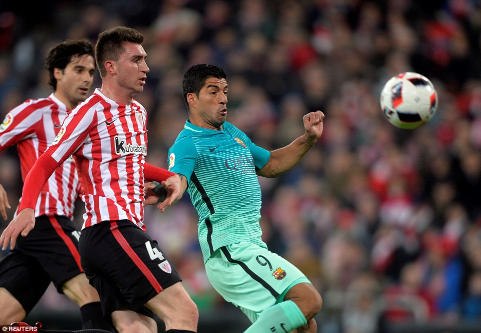 Aymeric Laporte tries to get his body between Luis Suarez and the ball as the visitors look to create another opportunity